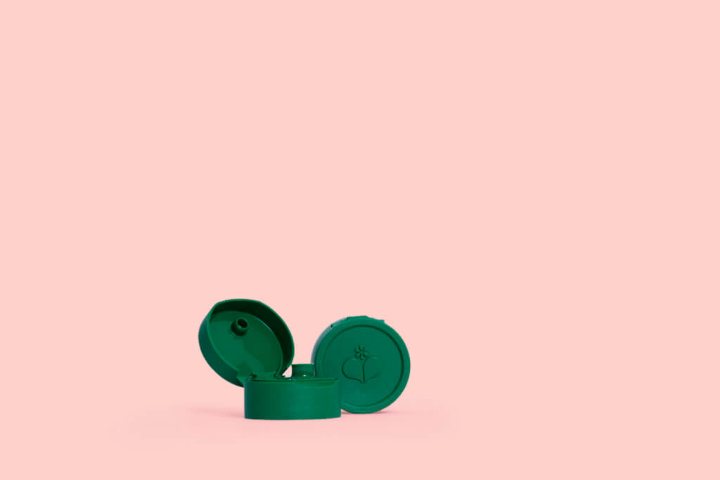 ECOVER GREEN CAP ON PINK